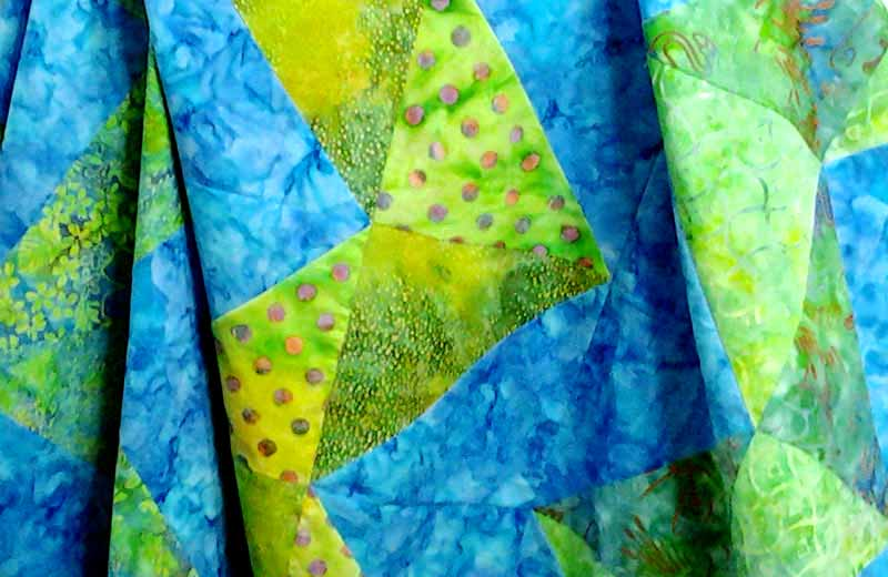 image of Batik HST Chevron Quilt with Batik Flying Geese Border