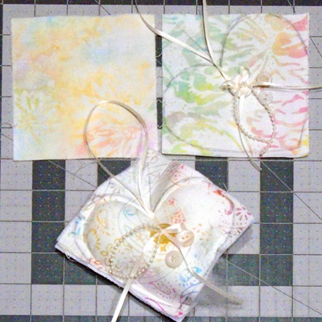 image of how to stuff a quilted fabric heart ornament
