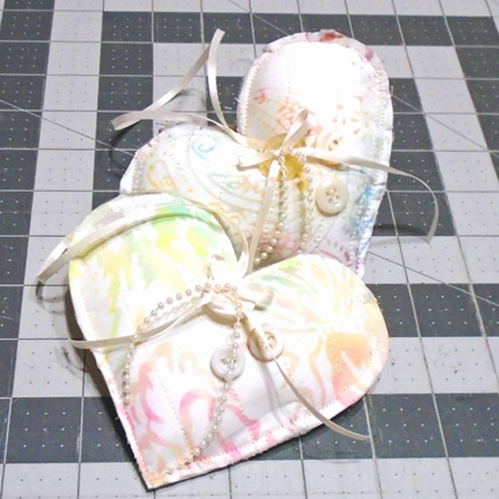 image of completed easy to make quilted fabric hearts