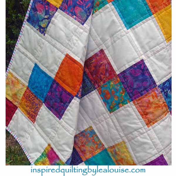 image of Easy Batik Charm Square Baby Quilt