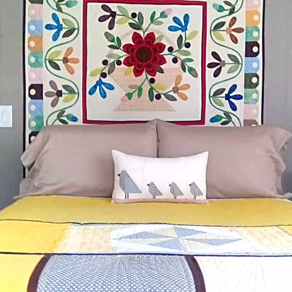 photo of Applique quilt wall hanging and bed quilt