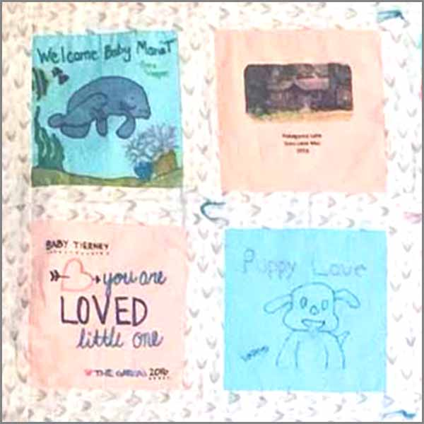 image of a baby memory patchwork manatee quilt block closeup