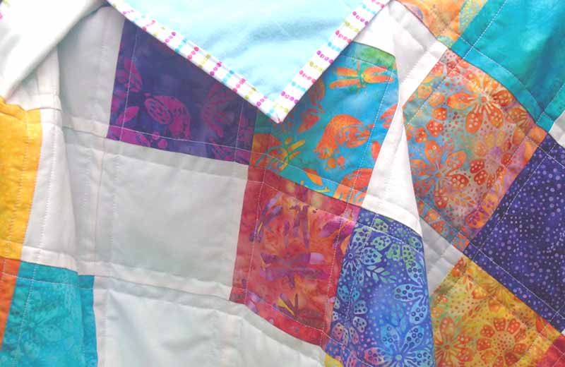 Image of Batik Charm Square Brick Path Baby Quilt with Flannel Backing