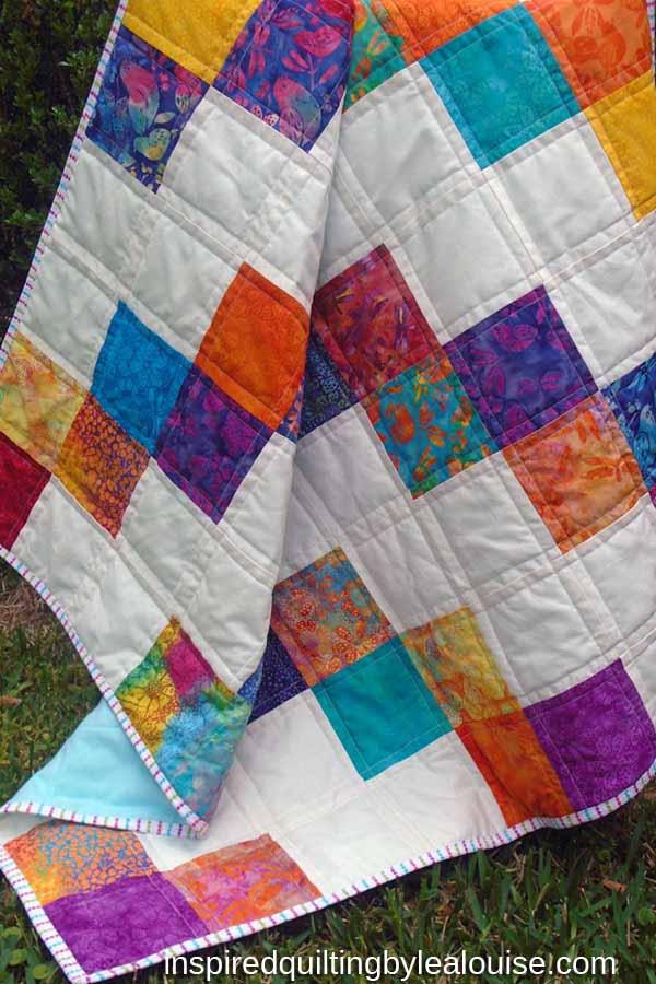 photo of Easy Batik Charm Square Baby Quilt