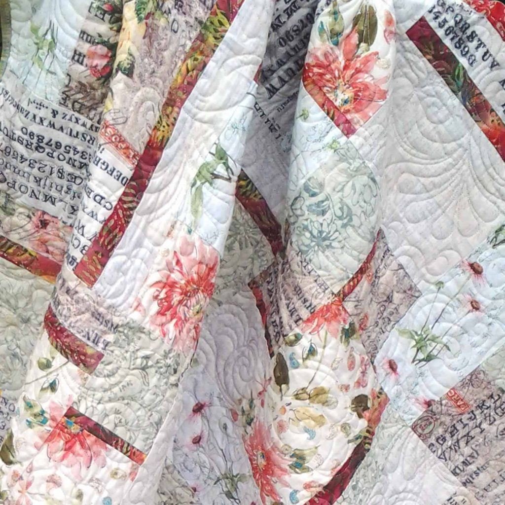 image of Modern low volume Fat Quarter Quilt with bold batik accents
