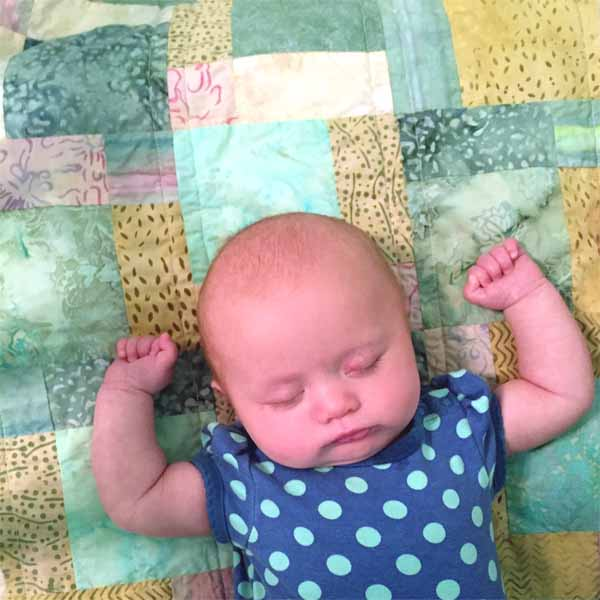 image of Batik Fat Quarter Baby Quilt made with Disappearing 9 Patch Block