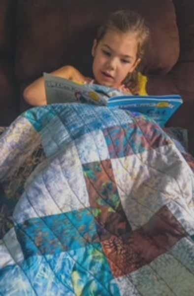 image of Batik Fat Quarter Disappearing 9 Patch Baby Quilt Idea