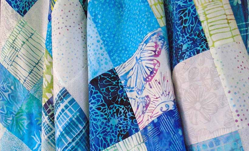 Batik Charm Square Baby Quilt made with Beyond the Reef fabrics