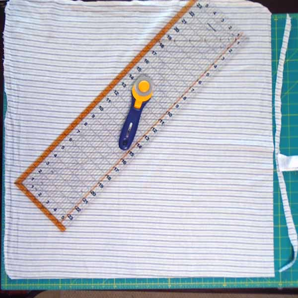 image of How to trim rag quilt blocks from receiving blankets