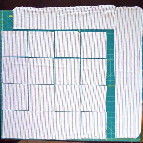 image of How to cut rag quilt blocks from receiving blankets