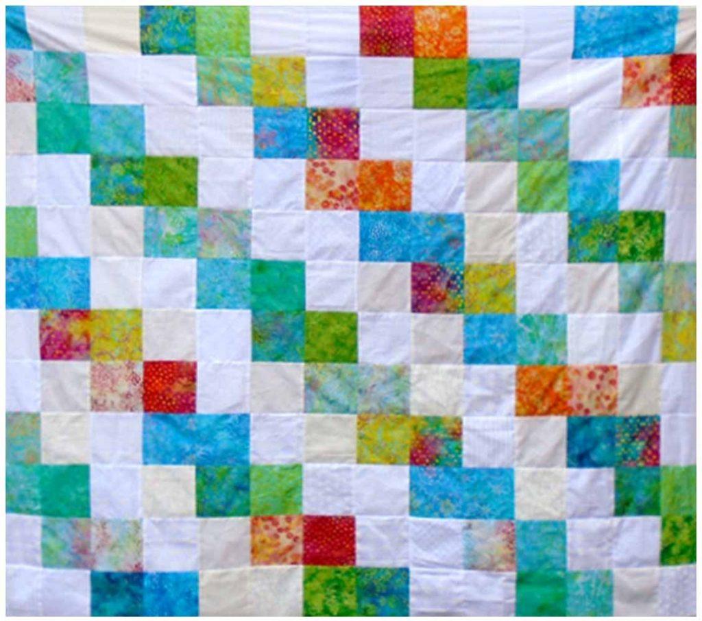 image of batik charm pack quilt top