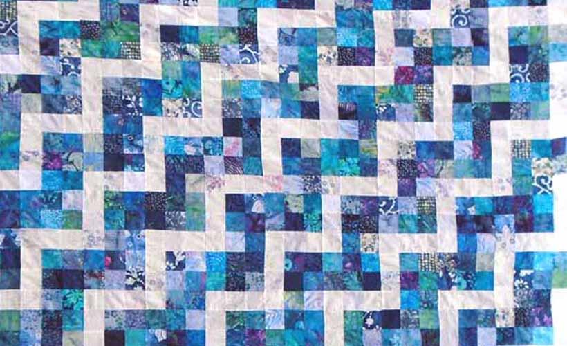 image of batik 9-patch rail fence quilt block layout