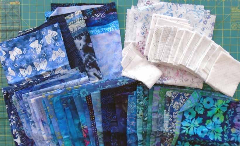 image of Batik & Low Volume Fat Quarter Quilt Selection for Scrappy Batik 9-Patch Rail Fence Quilt