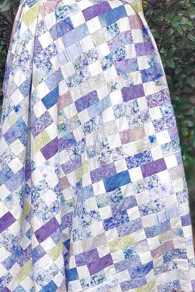 image of Charm Square Fabric Lap Quilt