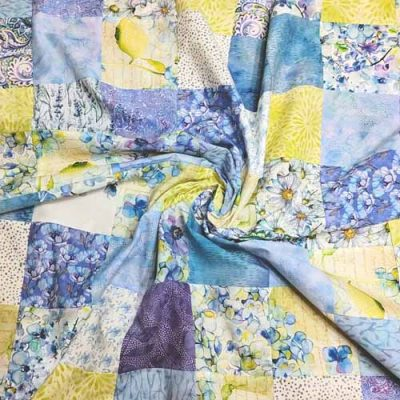 image of charm pack baby quilt